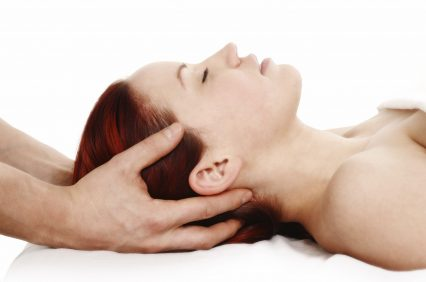 woman getting a head and shoulder massage on white background